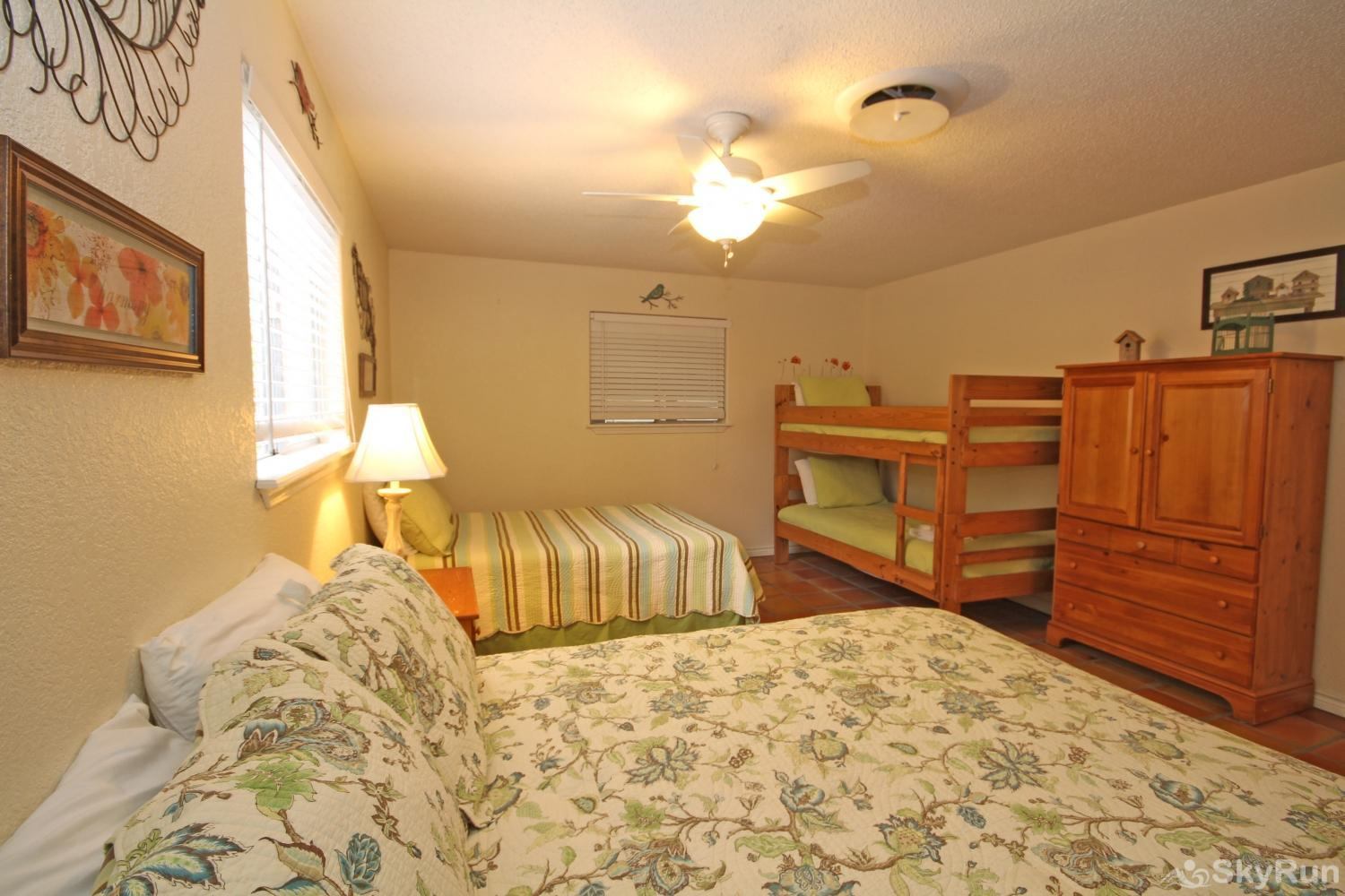 STAR OF TEXAS First Bedroom with Queen, Full, and Twin Bunk Beds