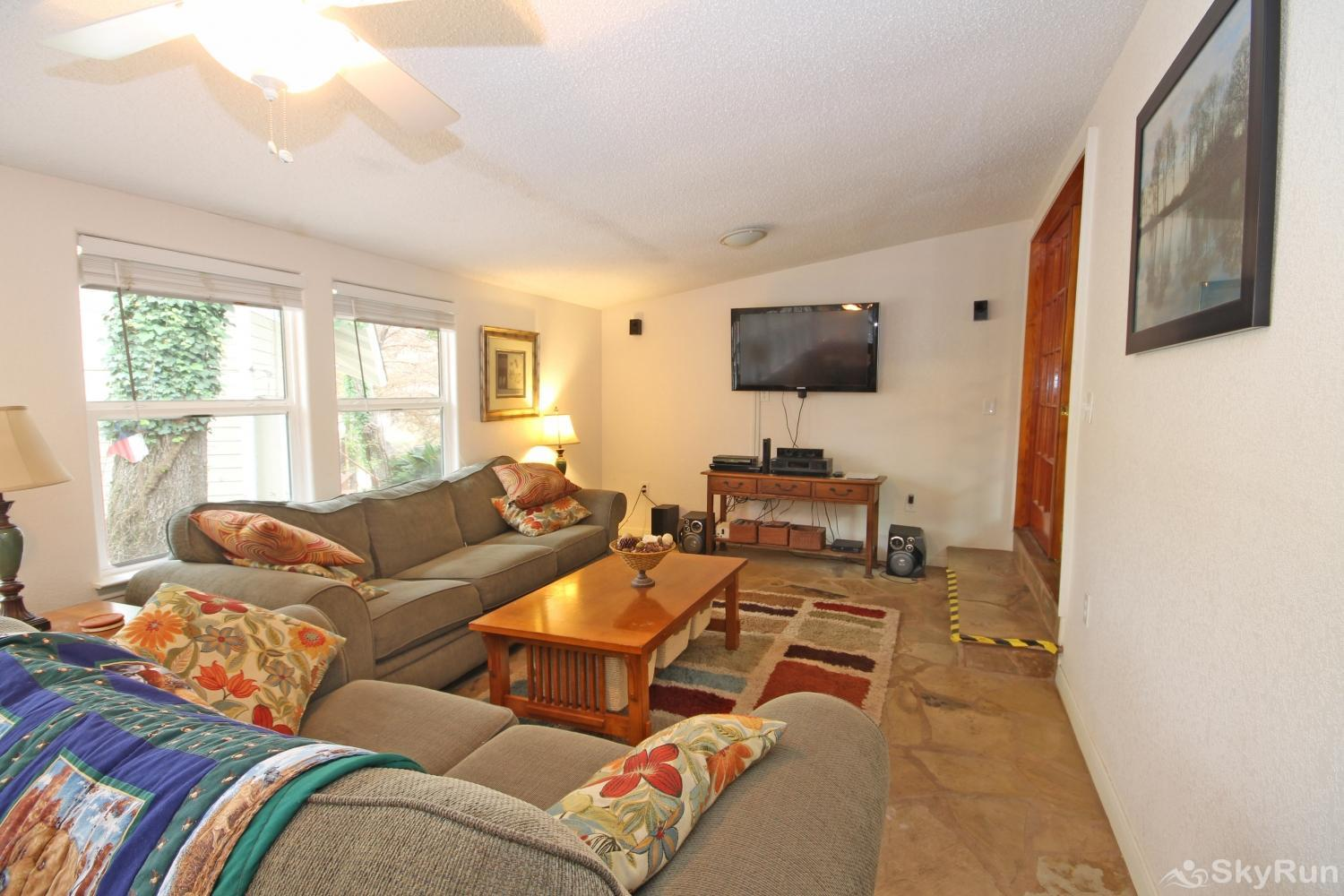 STAR OF TEXAS AND COTTAGE COMBO Second Living Area with HDTV and River View