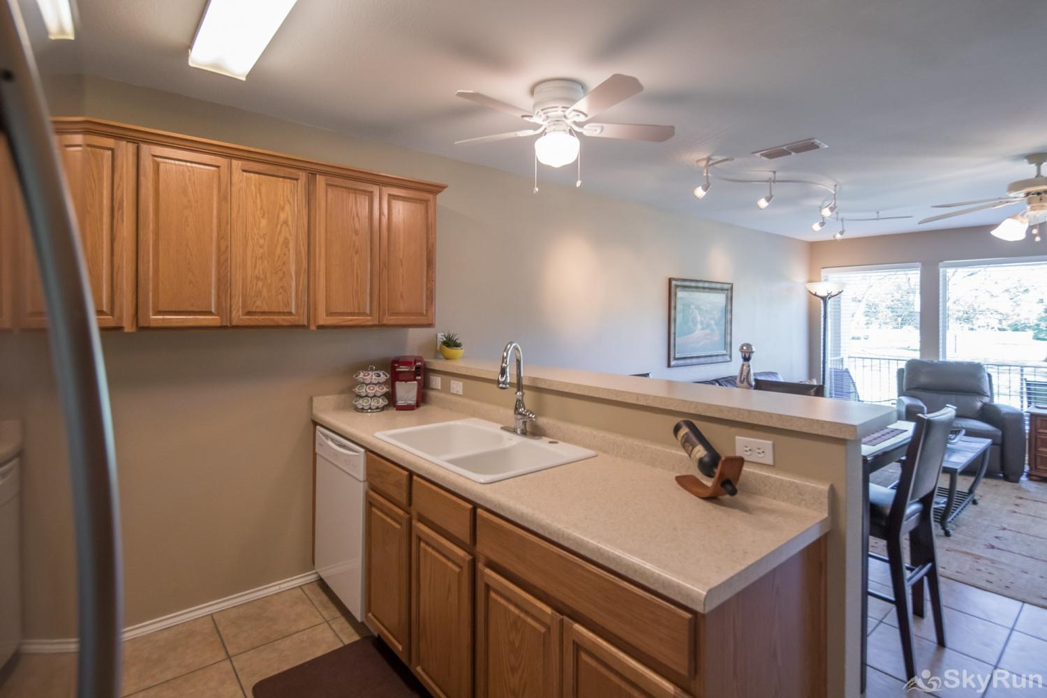 WATERWHEEL ESCAPE CONDO Kitchen Overlooking Living and Dining Areas