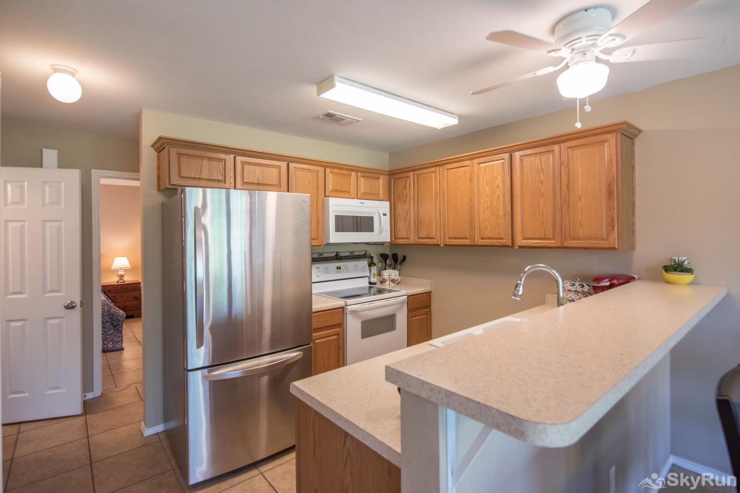 WATERWHEEL ESCAPE CONDO Kitchen Space with Cooking and Dining Essentials
