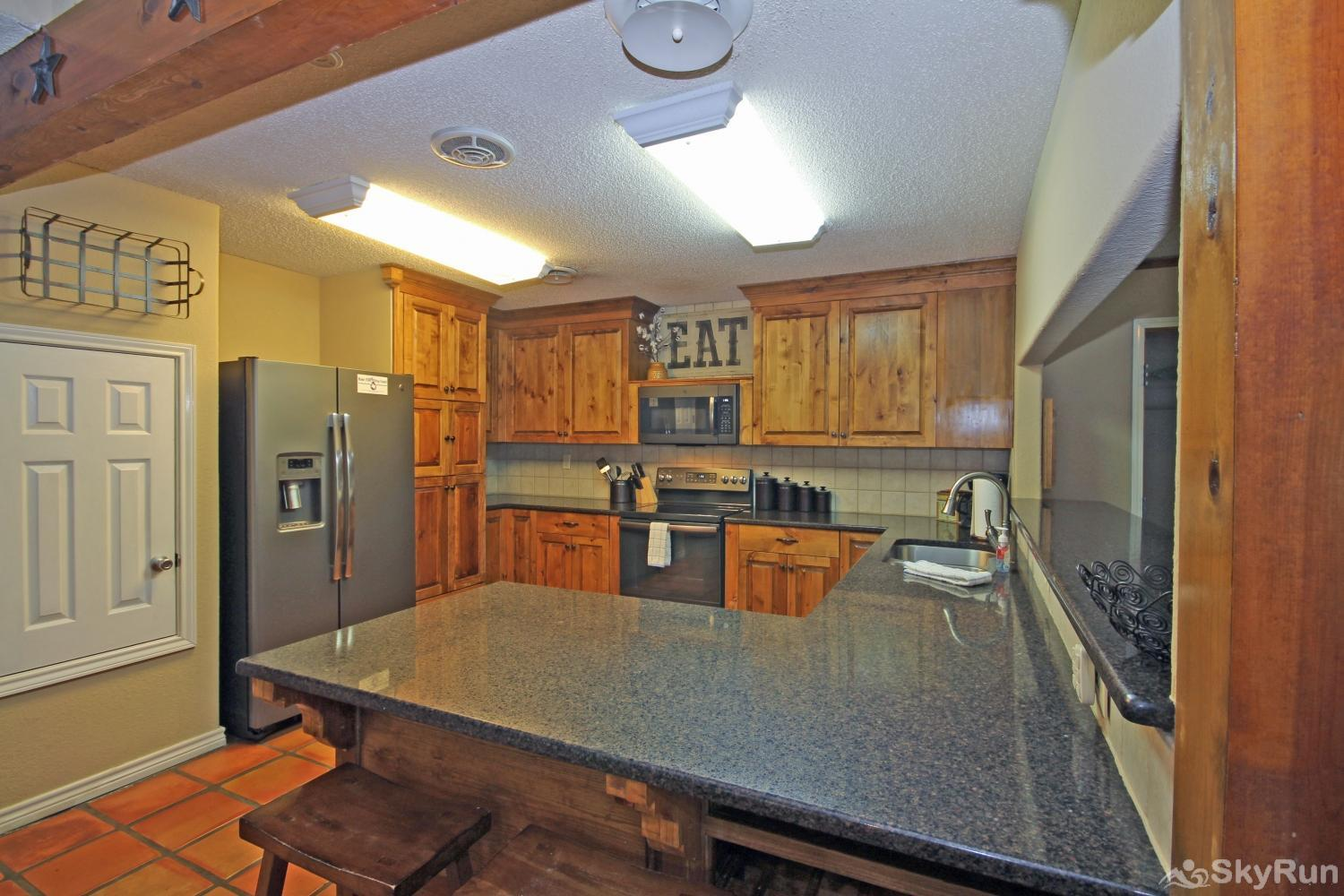 STAR OF TEXAS AND COTTAGE COMBO Kitchen equipped with all cooking and dining essentials